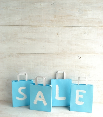 Light blue bargain sale shopping bags Stock Photo