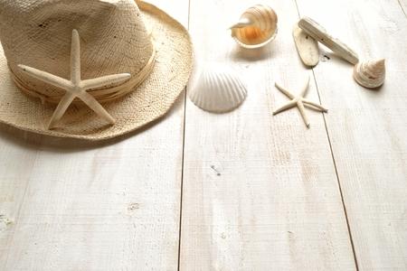 men s: Men s straw hat with shells Stock Photo