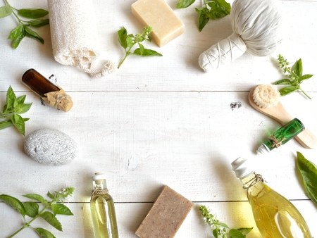 wooden aromatherapy: Aromatherapy supplies with basil leaves