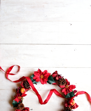 flower arrangement: Christmas wreath with red ribbon