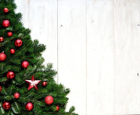 Red ornaments Christmas tree Standard-Bild