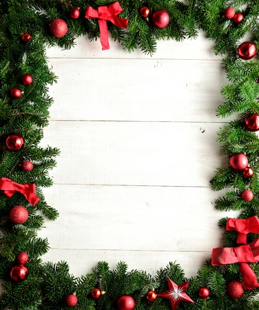Red Christmas ornaments on fir leaves.frame