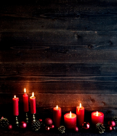 Red candles with ornament balls