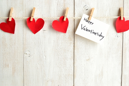 clothes pin: Valentines day message card and red hearts with clothes pin Stock Photo