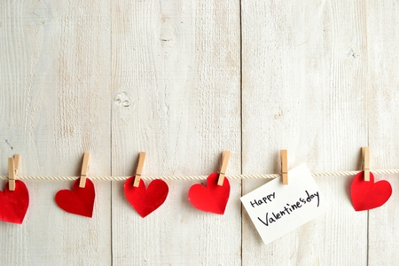 clothes pin: Valentines day message card and red heart with clothes pin