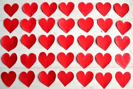Red heart paper cut out background Foto de archivo