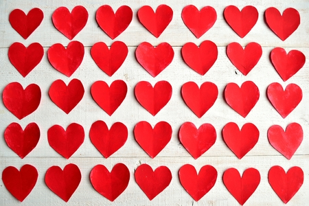 Red heart paper cut out background Фото со стока
