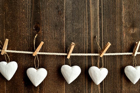 clothes pins: White heart ornaments with clothes pins Stock Photo