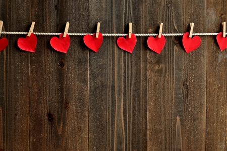 clothes pins: Red heart paper cut out with clothes pins