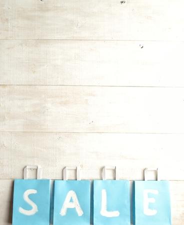 bargain: Light blue bargain sale shopping bags Stock Photo