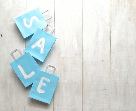 bargains: Light blue bargain sale shopping bags Stock Photo