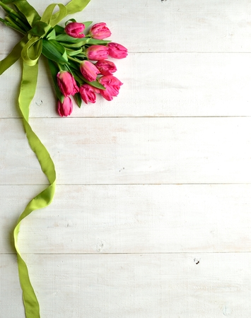 yellow green: Pink tulips bouquet with yellow green ribbon