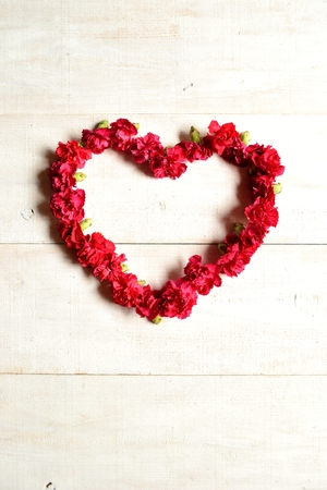 heart shaped: Red carnations heart shaped wreath Stock Photo