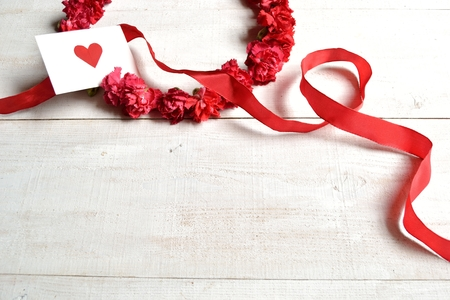 carnations: Red carnations wreath with message card