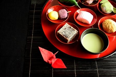 maccha: Japanese cakegreen tea and origami crane Stock Photo
