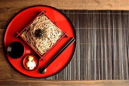 soba noodles: Chilled soba noodles on red tray