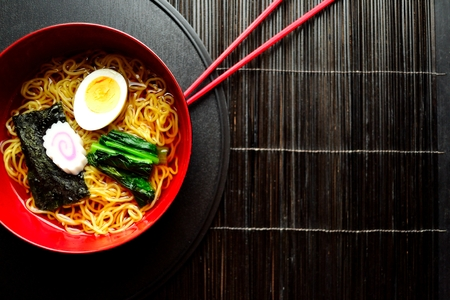 Ramen noodles with red chopsticks Stock Photo