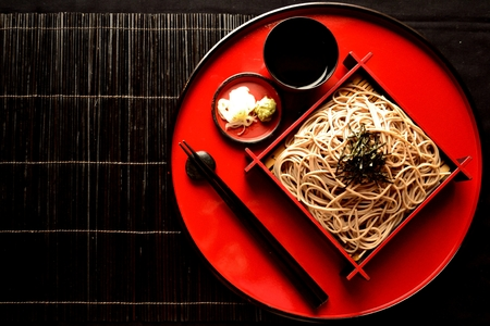 Chilled soba noodles on red tray