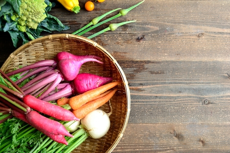 Colorful root vegetables on bamboo basket Imagens