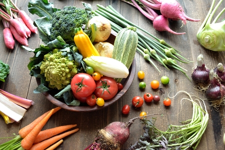 Colorful vegetables on wooden background