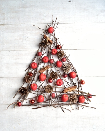 twigs: Christmas tree.Red apples and twigs