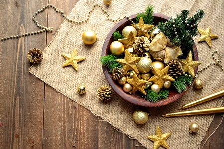 cone shaped: Christmas tree, gold ornaments and candle sticks