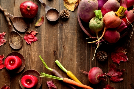 autumn food: Colorful root vegetables with red fall leaves