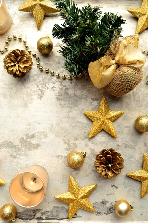 gold tree: Gold star shaped ornaments and Christmas tree