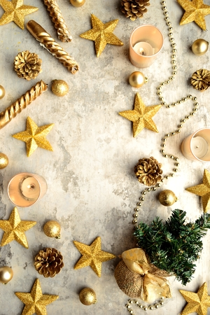 cone shaped: Gold star shaped ornaments and Christmas tree