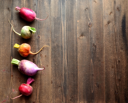 root vegetables beet root: Colorful root vegetables on the wooden background Stock Photo