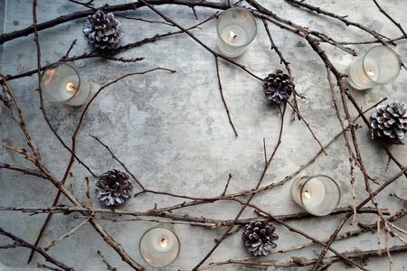 twigs: Dead twigs, pine cones and candles Stock Photo
