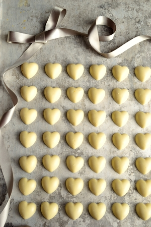 shaped: Heart shaped white chocolate with silver ribbon