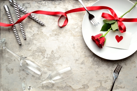 dinner: Red rose with red heart message card on the white dish