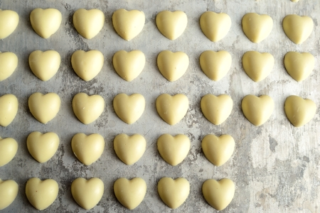 heart shaped: Heart shaped white chocolates on the silver background