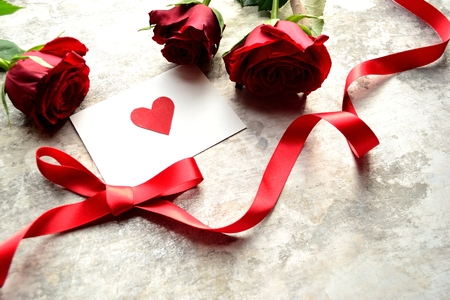 3 red roses with red heart message card Stock Photo