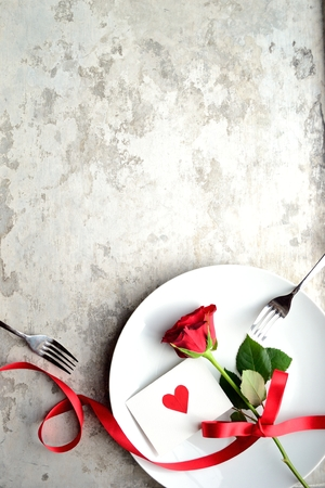 red food: Red rose with red heart message card on the white dish