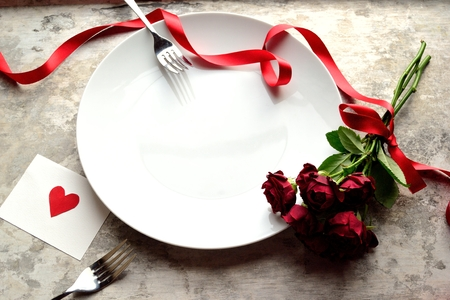 love rose: Red rose bouquet, red heart message card and white dish Stock Photo