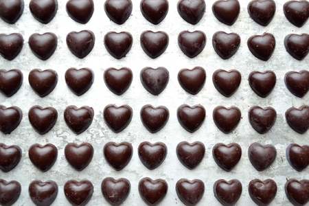 heart shaped: Heart shaped chocolates on the silver background