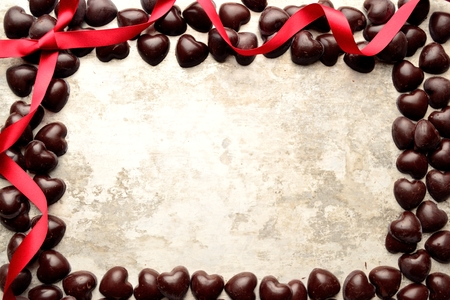 shaped: Heart shaped chocolates with red ribbon