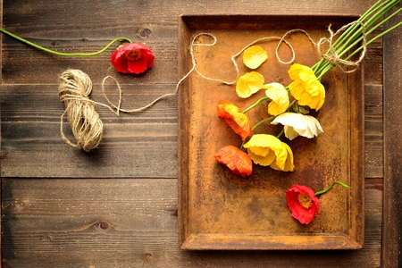 rusted: Colorful poppies bouquet on the rusted tray