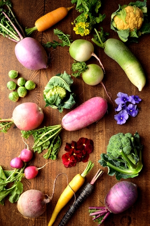 root vegetables beet root: Colorful root vegetables with edible flowers on the wooden background