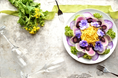 a pair of: Purple radish salad with a pair champagne glass Stock Photo