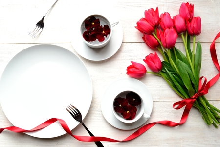 were: Red tulip bouquet and white dish were