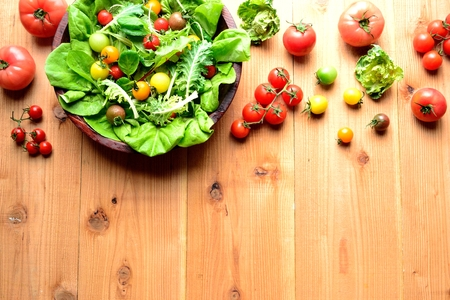 the greens: Colorful tomatoes and mesclun greens salad Stock Photo