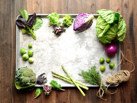 green and purple vegetables: Purple and green spring vegetables on the silver tray