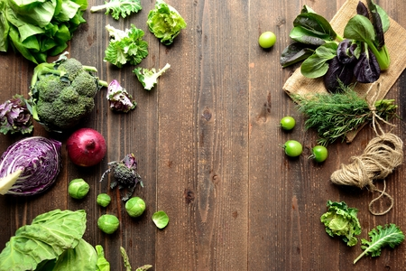 green and purple vegetables: Purple and green spring vegetables on the wooden background