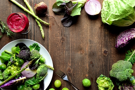 green and purple vegetables: Purple and green spring vegetables salad with beet root juice