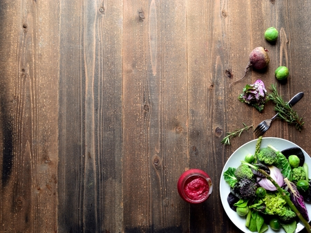 Purple and green spring vegetables salad with beet root juice