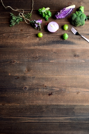 green and purple vegetables: Purple and green spring vegetables with herb Stock Photo