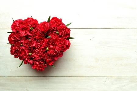 carnations: Heart shaped red carnations flower arrangement